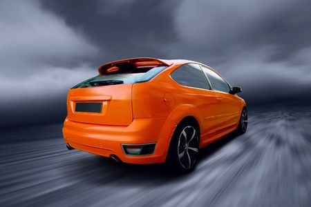 Beautiful orange sport car on road photo