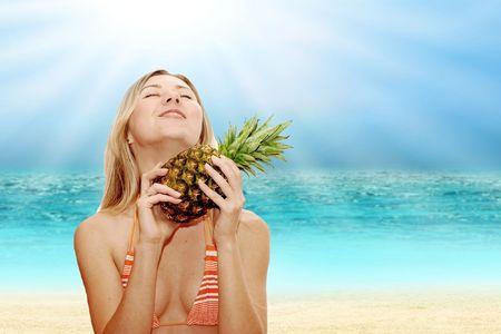 girl with ananais on tropical beach Stock Photo - 7928064