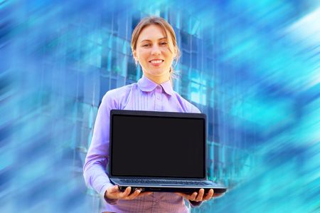 Happiness business woman with laptop on blured background photo