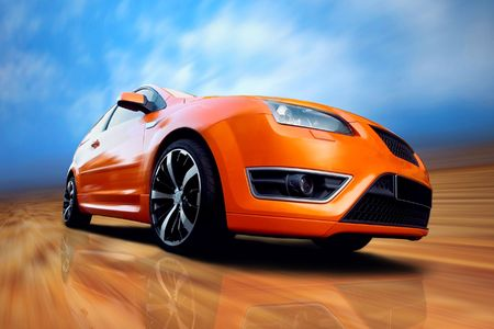 Beautiful orange sport car on road Stock Photo - 7928146
