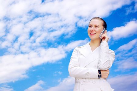 Happiness businesswoman call by phone on blue sky  Stock Photo - 7996010