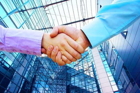 partnership power: Shaking hands of two business people Stock Photo