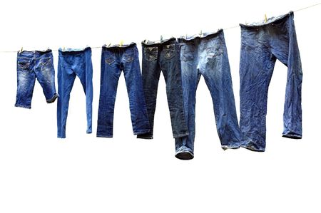 dry grass: Jeans on a clothesline to dry