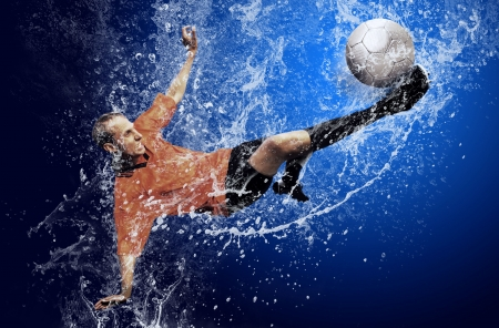 Water drops around football player under water on blue background Stock Photo - 7997211