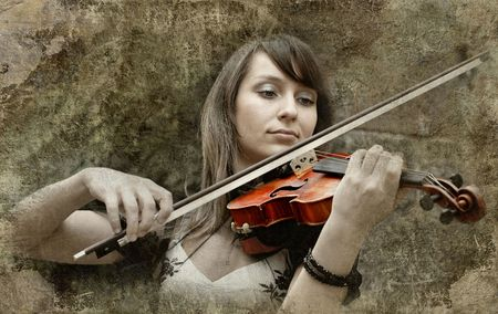 Beautiful female violinist playing violin on the grunge background Stock Photo - 7997214