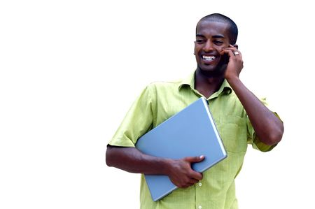 Young happy man or student with laptop and phone on the business background Stock Photo - 7997221