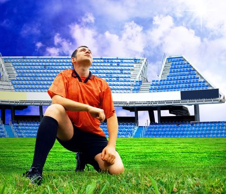Happiness football player after goal on the field of stadium under sky Stock Photo - 7997294
