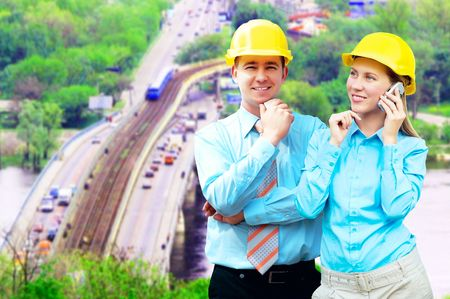 Young architects wearing a protective helmet standing on the building background Stock Photo - 7997253