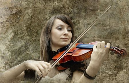 Beautiful female violinist playing violin on the grunge background Stock Photo - 8066300