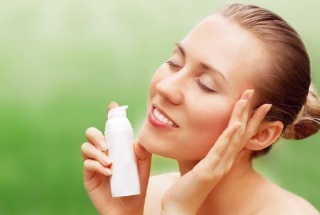 Portrait of sexy young women with beautiful face and perfume  photo