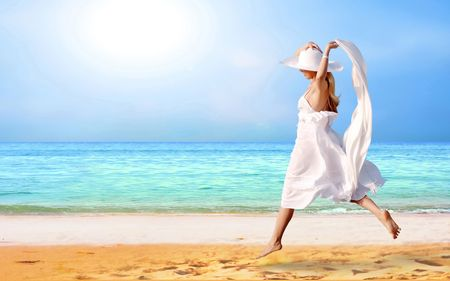 Young beautiful women in the white on the sunny tropical beach Stock Photo - 8114770