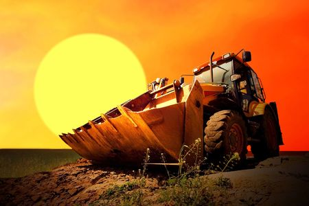 Yellow tractor on golden surise sky Stock Photo - 8114752