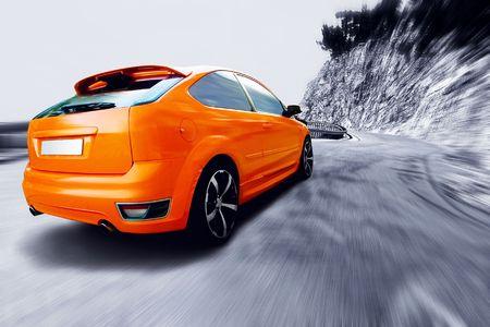 Beautiful orange sport car on road  Stock Photo - 8170600