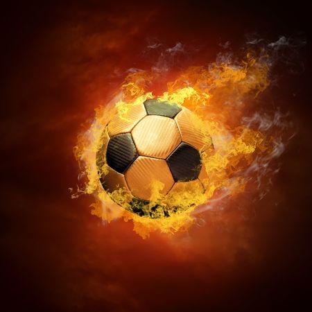 ballon foot: Ballon chaud sur la vitesse en feux de flamme  Banque d'images