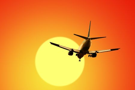 Airplane on sunset sky  photo