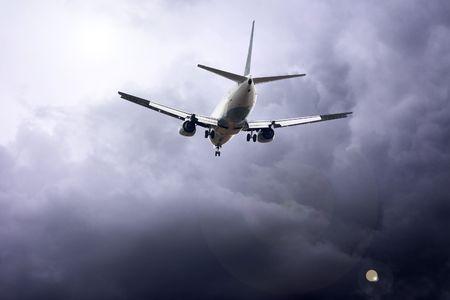 Airplane on the blue sky Reklamní fotografie