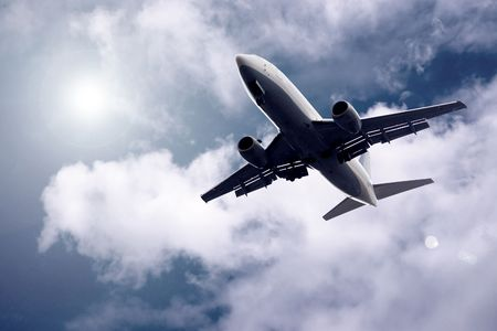travel industry: Airplane on blue sky