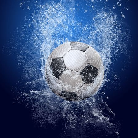 Water drops around soccer ball on blue background photo