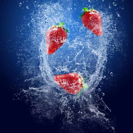 water feature: Water drops around fruits on blue background
