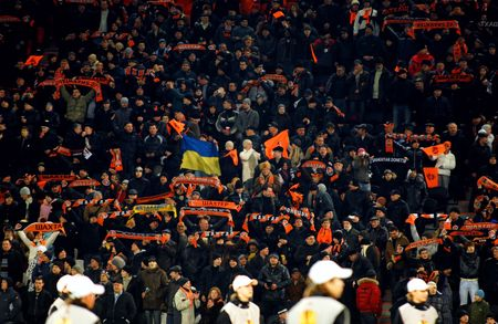 donbass: DONETSK, UKRAINE - FEB 25: Shakhtar team supporters watch the match UEFA Europa League between FC Shakhtar(UKR) vs. Fuham FC(ENG) at Donbass Arena stadium February 25, 2010 in Donetsk, Ukraine.