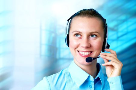 Happiness businesswoman speak in headphones on blur business architecture background photo