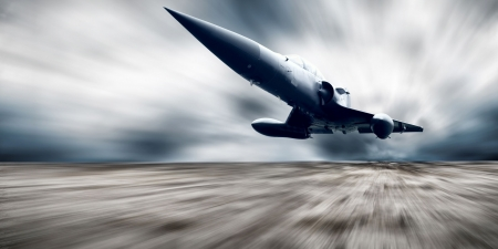 Military airplan on the speed photo