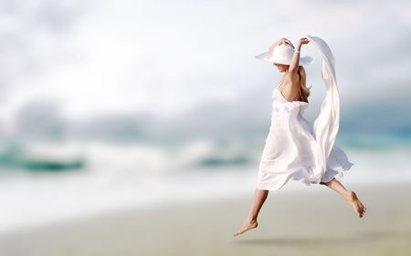 Young beautiful women in the white on the sunny tropical beach Stock Photo - 8171877