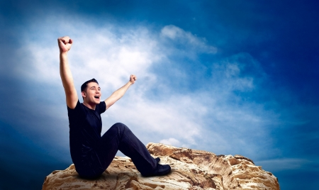 hopes: Man on the top of mountain. Stock Photo