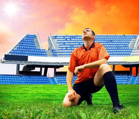Happiness football player after goal on the field of stadium under sky Stock Photo - 8188739