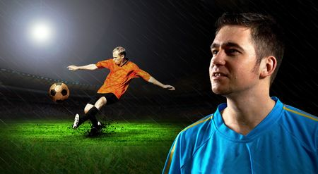Portrait of Soccer player on the field in night rain photo
