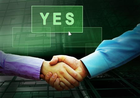 Handshake of two businessmans and text on the light button photo