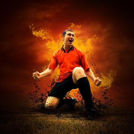 Football player in fires flame on the outdoors field Stock Photo - 8254908