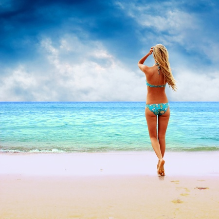 blonde bikini: Young beautiful women on the sunny tropical beach in bikini