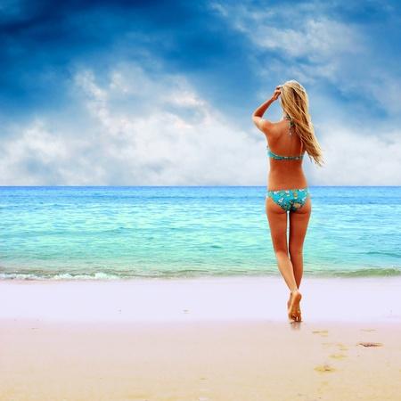 swimsuit model: Young beautiful women on the sunny tropical beach in bikini