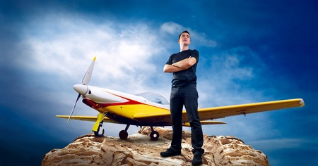 Man on the top of mountain and airplane Stock Photo - 8254954