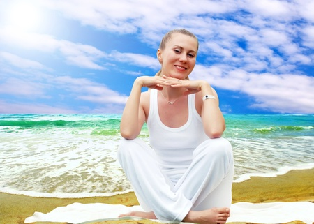 Young beautiful women in white, relaxation on the sunny tropical beach Stock Photo - 8254957