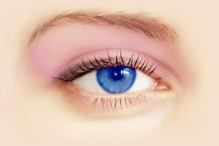 part of the body: Beautiful female blue eye. Macro shooting