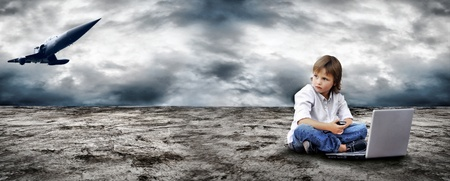 Young boy watch in the field-glass under sky photo