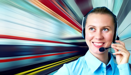 Businesswomen and train on speed in railway station photo