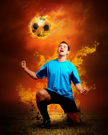 Football player in fires flame on the outdoors field photo