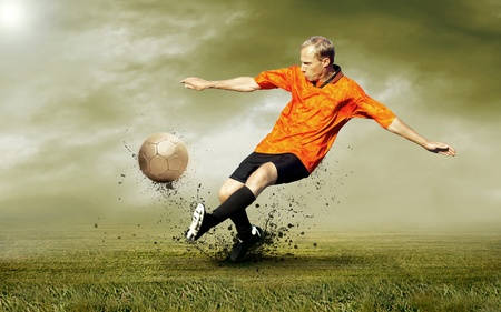 Shoot of football player on the outdoors field photo