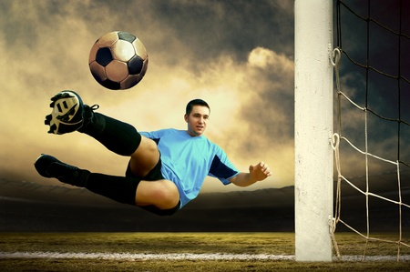 Shoot of football player on the outdoor field Stock Photo