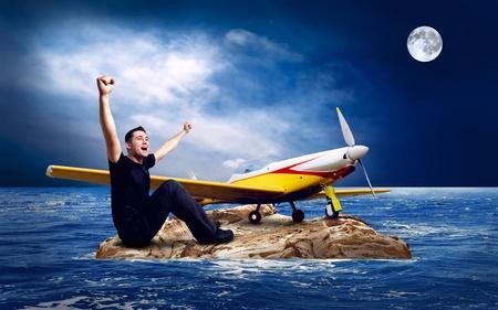 Man on the island in sea. photo