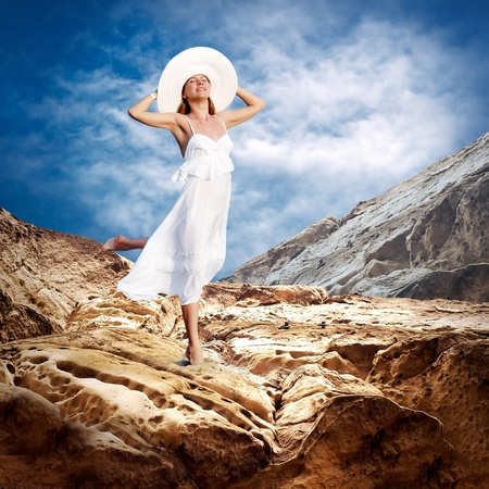 Beautiful girl in White on the mauntain under sky with clouds Stock Photo - 8377616