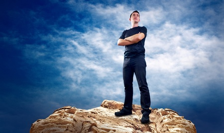 Man on the top of mountain. Stock Photo - 8377918