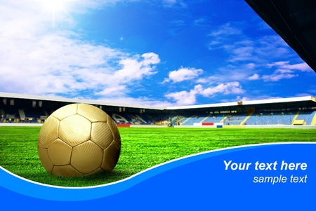 Ball on the field of stadium with blue sky and sample text photo