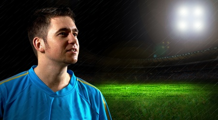 lightweight: Portrait of Soccer player on the field in night rain