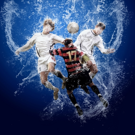 Water drops around football players under water on blue background photo