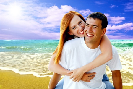 Young love couple smiling under tropical beach Stock Photo - 8486967
