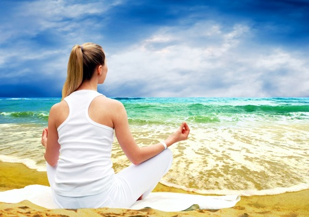 Young beautiful women in white, relaxation on the sunny tropical beach Stock Photo - 8487762